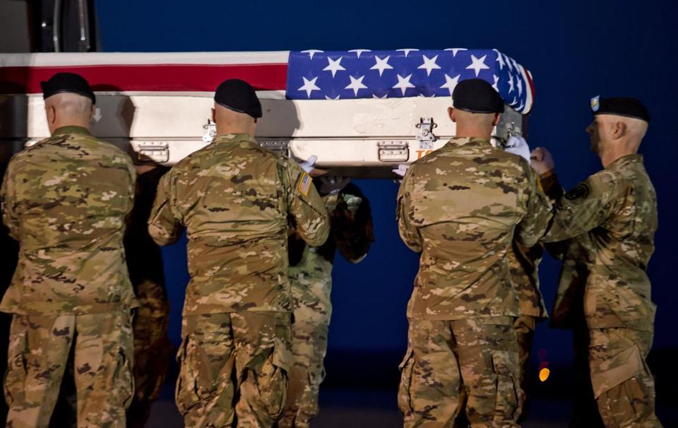 Members of the Old Guard carried the transfer case of US Army Sgt. Dillon Baldridge at Dover Air Force Base in Dover, Del., in June 2017..