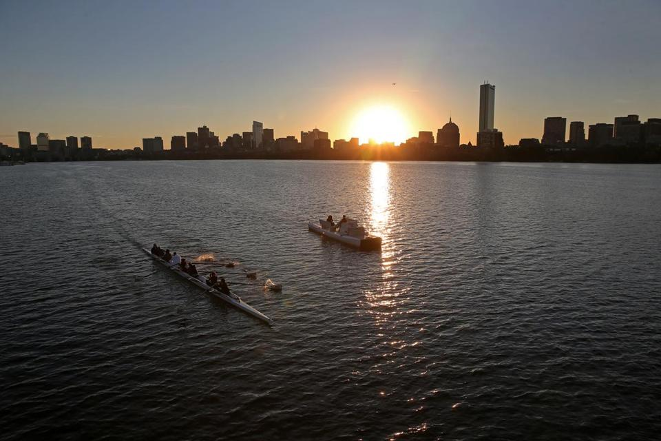 Rowers on the Charles River at sunrise on Friday.