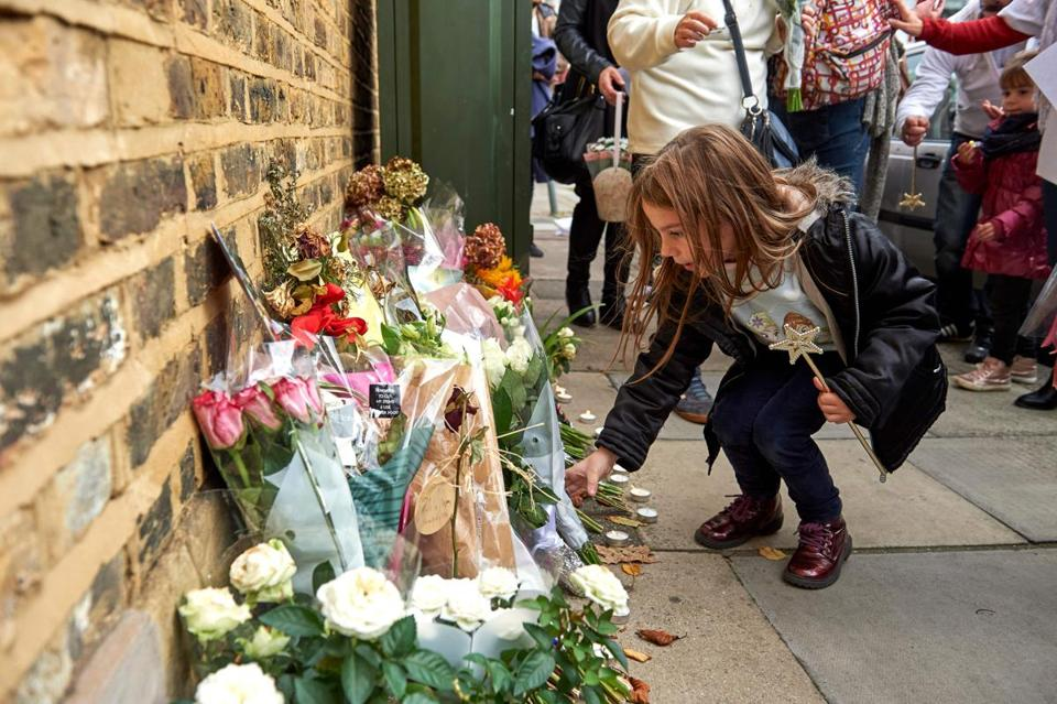 Well-wishers left floral tributes in memory of slain French au pair Sophie Lionnet outside a residential property in Wimbledon, west London.