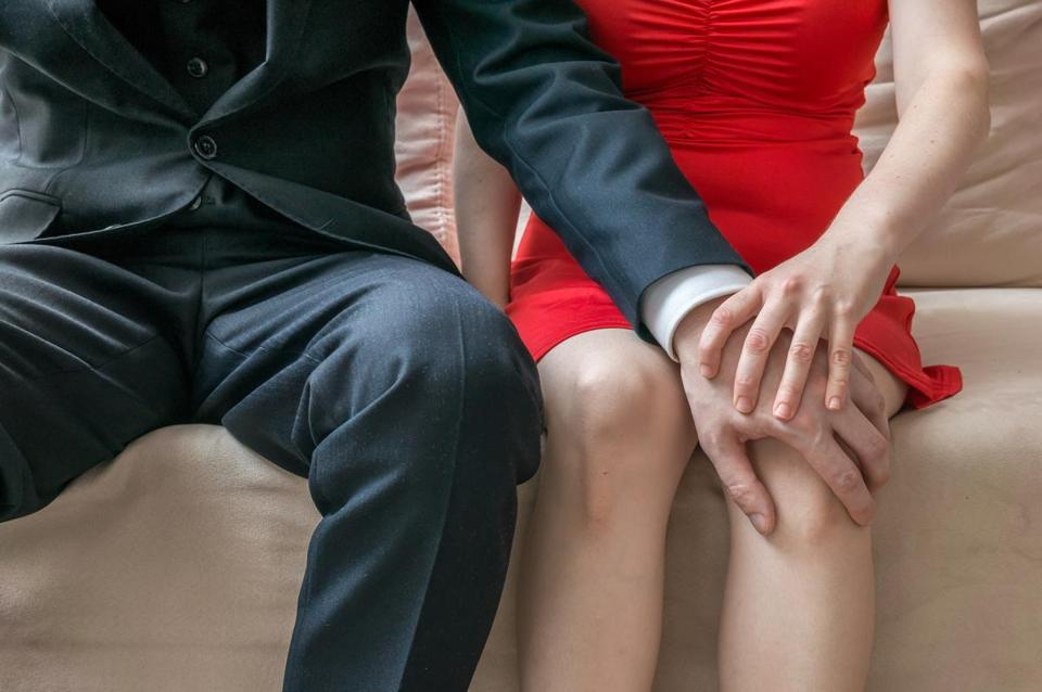 17harassmentdata - Harassment at workplace. Manager is touching knee of his secretary. (AP)