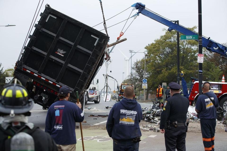 A dump truck containing scrap rolled over and spilled its contents in Sullivan Square.