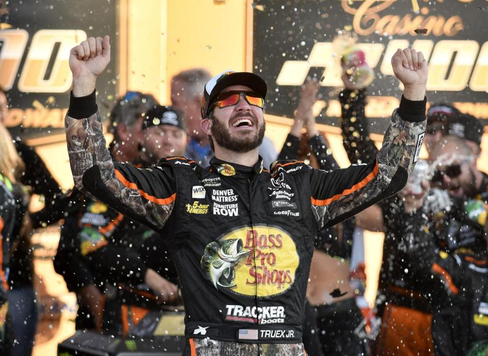 Martin Truex Jr. celebrates in victory lane after winning a NASCAR Cup Series auto race at Kansas Speedway Sunday, Oct. 22, 2017, in Kansas City, Kan. (AP Photo/Ed Zurga)
