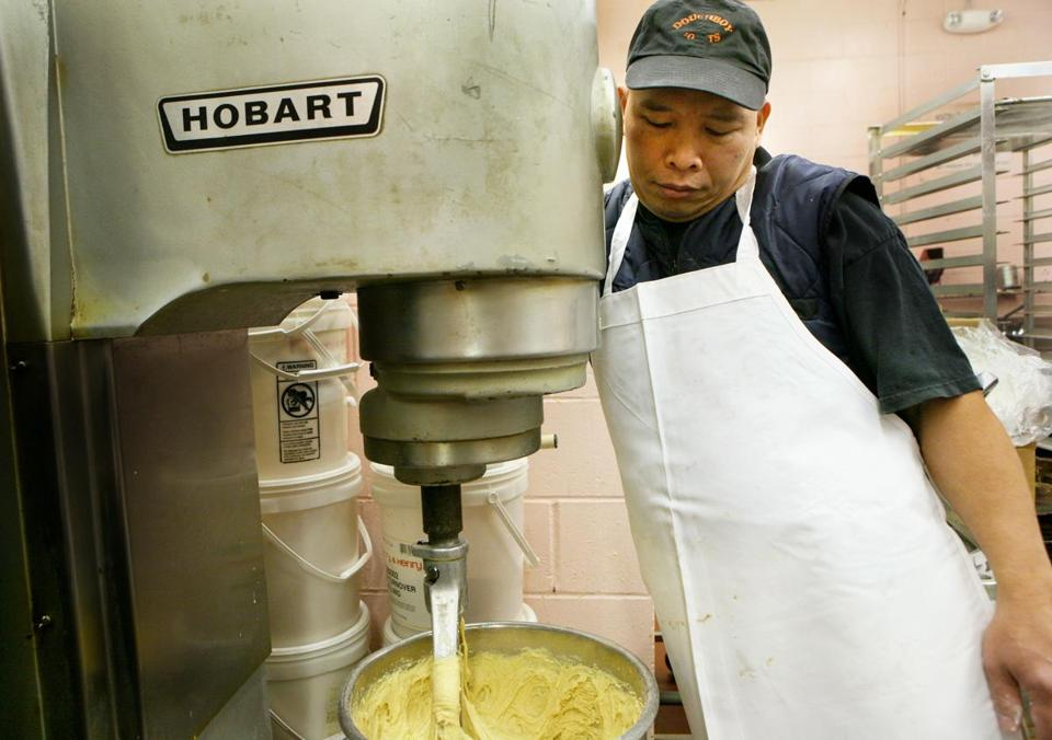 Doughboy Donuts has been a South Boston institution for four decades. In this photo, baker Hung Bui prepared batter for a cake doughnut.