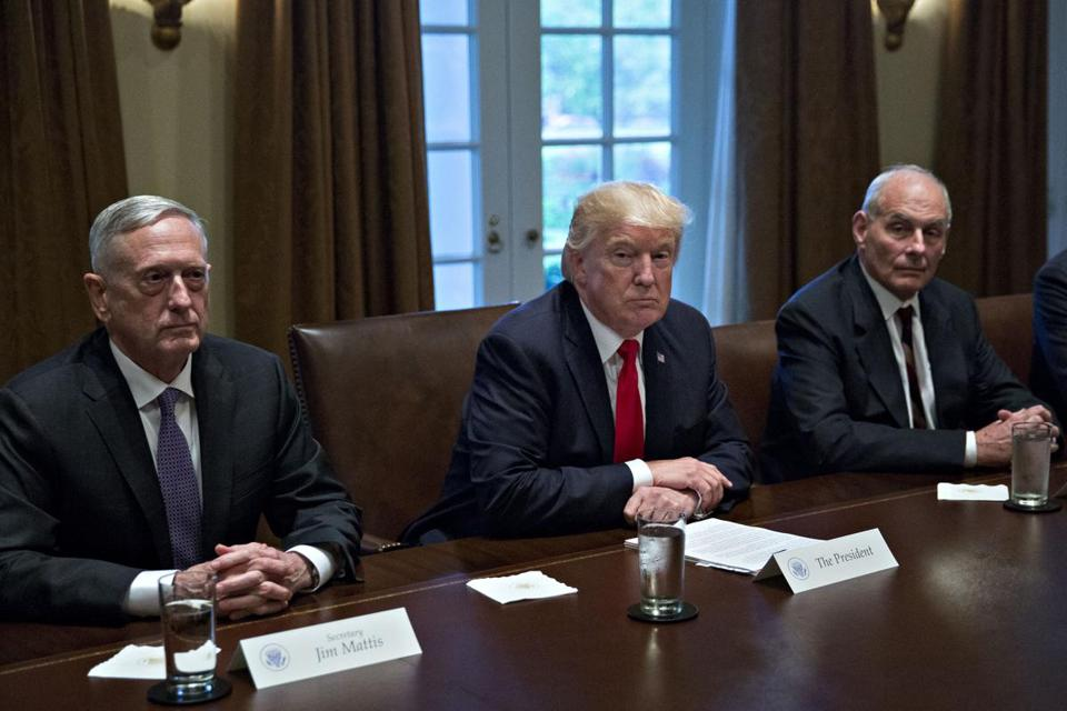 From left: Secretary of Defense Jim Mattis, President Trump, and Chief of Staff John Kelly during a briefing with senior military leaders in the White House on Oct. 5.