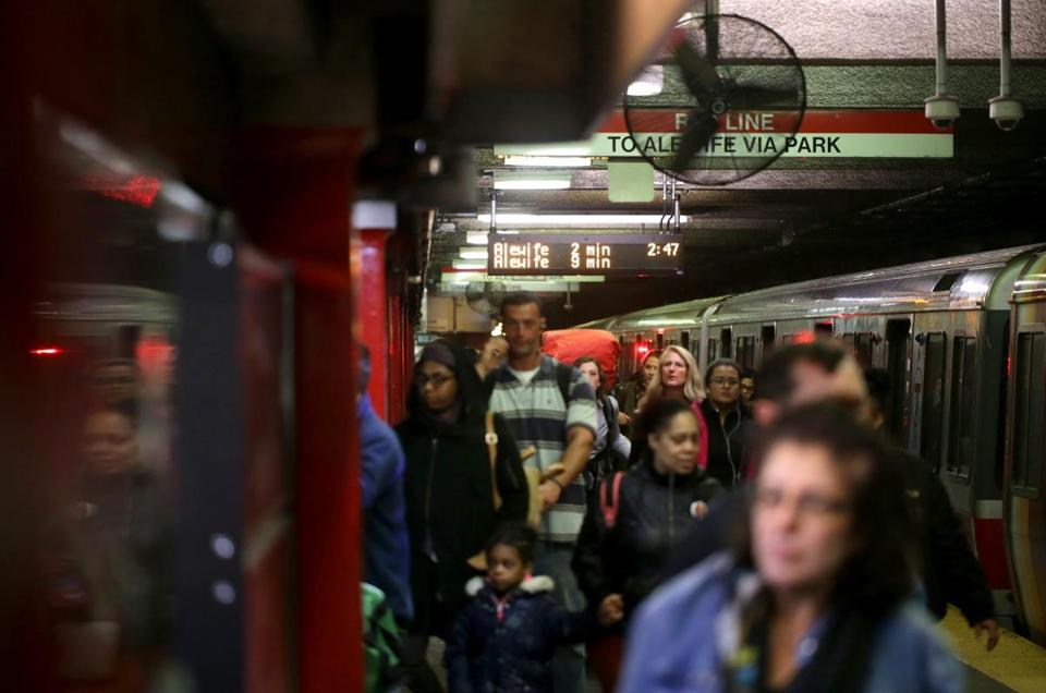 10/25/2017 Boston Ma - Commuters disembark from a Red Line Train at Downtown Crossing, as the countdown clock shows the time of next train to arrive at Downtown Crossing. (Jonathan Wiggs\Globe Staff) Reporter:Topic.