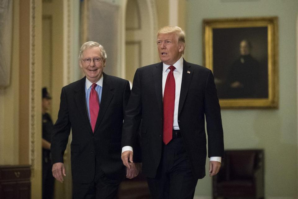 Senate Majority Leader Mitch McConnell and President Trump walked through the Capitol on Tuesday.