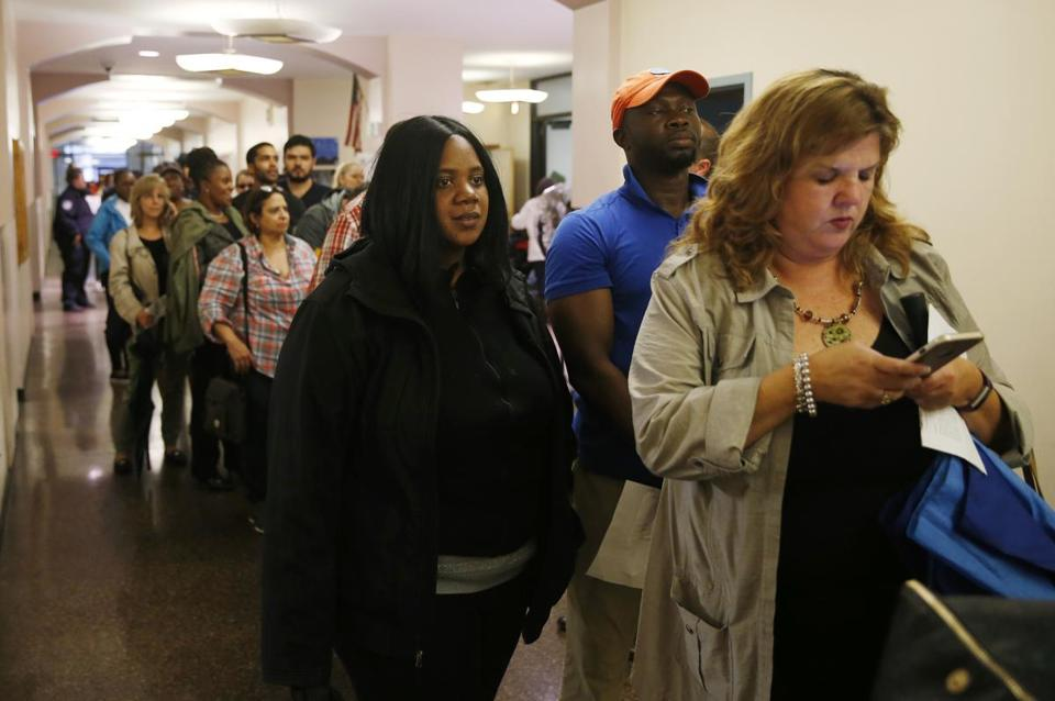 People waited in line for an Income Restricted Housing Lottery at The Beverly on Court Street.