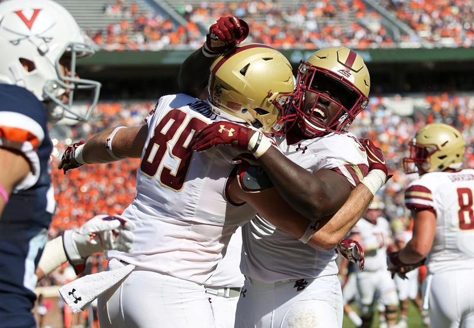 CHARLOTTESVILLE, VA - OCTOBER 21: Tommy Sweeney #89 and Jon Hilliman #32 of the Boston College Eagles celebrate a touchdown in the third quarter during a game against the Virginia Cavaliers at Scott Stadium on October 21, 2017 in Charlottesville, Virginia. (Photo by Ryan M. Kelly/Getty Images)