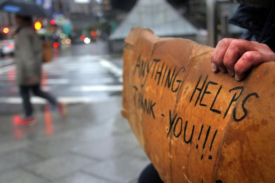David, a panhandler in Boston, held up this sign outside South Station on a rainy day this fall.