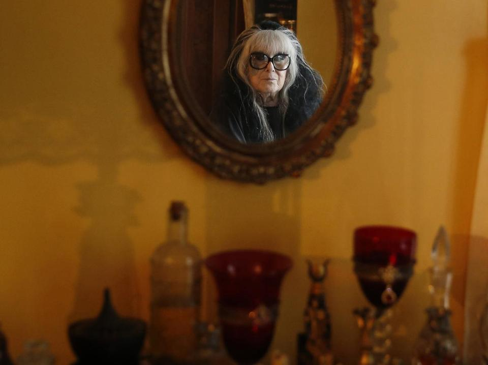 Laurie Cabot reflected in a mirror inside her home in Salem.