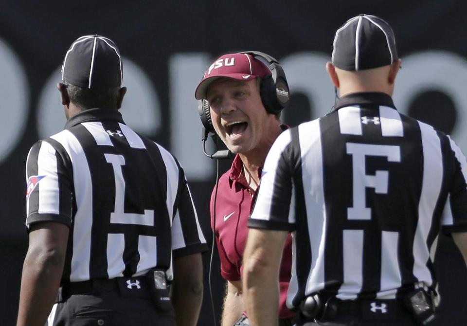 Florida State head coach Jimbo Fisher, center, argues a call in the first half of an NCAA college football game against Wake Forest in Winston-Salem, N.C., Saturday, Sept. 30, 2017. (AP Photo/Chuck Burton)
