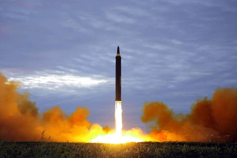 "(FILES) This file photo from North Korea's official Korean Central News Agency (KCNA) taken on August 29, 2017 and released on August 30, 2017 shows North Korea's intermediate-range strategic ballistic rocket Hwasong-12 lifting off from the launching pad at an undisclosed location near Pyongyang. Nuclear-armed North Korea's testing of long-range missiles that could possibly reach US soil has kindled debate in Japan and South Korea about developing their own nuclear deterrent, prompting fears of a North East Asian arms race. / AFP PHOTO / KCNA VIA KNS / STR / South Korea OUT / REPUBLIC OF KOREA OUT ---EDITORS NOTE--- RESTRICTED TO EDITORIAL USE - MANDATORY CREDIT ""AFP PHOTO/KCNA VIA KNS"" - NO MARKETING NO ADVERTISING CAMPAIGNS - DISTRIBUTED AS A SERVICE TO CLIENTS THIS PICTURE WAS MADE AVAILABLE BY A THIRD PARTY. AFP CAN NOT INDEPENDENTLY VERIFY THE AUTHENTICITY, LOCATION, DATE AND CONTENT OF THIS IMAGE. THIS PHOTO IS DISTRIBUTED EXACTLY AS RECEIVED BY AFP. TO GO WITH NKorea-nucelar-missile-Japan-SKorea-politics, FOCUS by Shingo Ito and Park Chan-Kyong / STR/AFP/Getty Images"