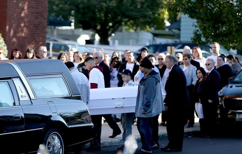 Pallbearers carried the casket to the funeral Mass for Javian Candolario at St. Michael Church in Lowell.