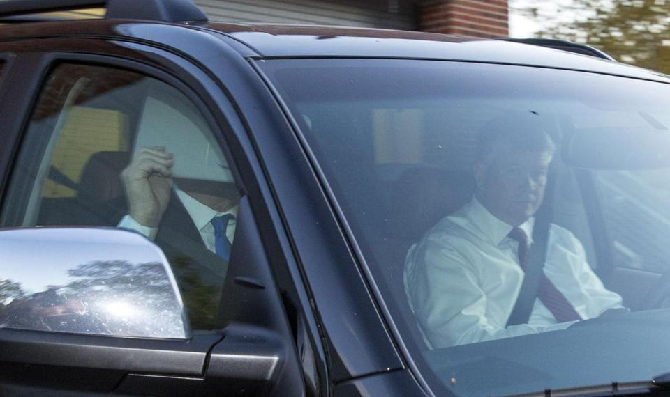 Paul Manafort covered his face as he left his home Monday.