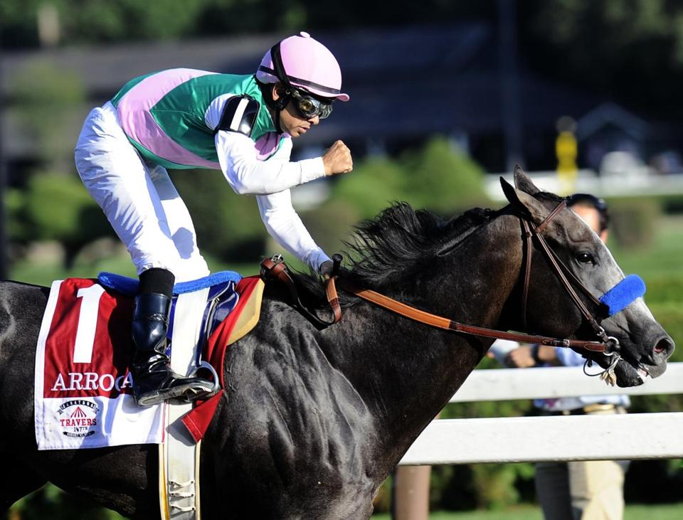 "FILE - In this Aug. 27, 2016, file photo, Jockey Mike Smith celebrates aboard Arrogate after winning the Travers Stakes horse race at Saratoga Race Course in Saratoga Springs, N.Y. The ride is far from over for Smith, even at age 51. The jockey known as ""Big Money Mike"" is poised for another lucrative weekend in the Breeders' Cup at Santa Anita with mounts in the $2 million Distaff on unbeaten Songbird on Friday and in the $6 million Classic aboard Travers winner Arrogate on Saturday. (AP Photo/Hans Pennink, File)"