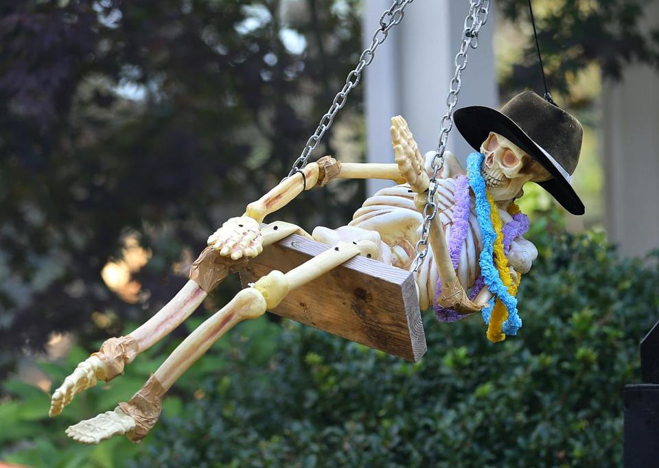 Winchester-10/31/17- John Downs has been assembling elaborate mechanical halloween decorations in his parents front yard on Franklin Road for 14 years. A skeleton goes around on a swing set. In recent years he has put a donation box out front of the dispaly to seek donations for the Children's Hospital. The displays work off of electricity and air pressure through hoses that run to an air compressor in the garage. (John Tlumacki/Globe Staff)(metro)