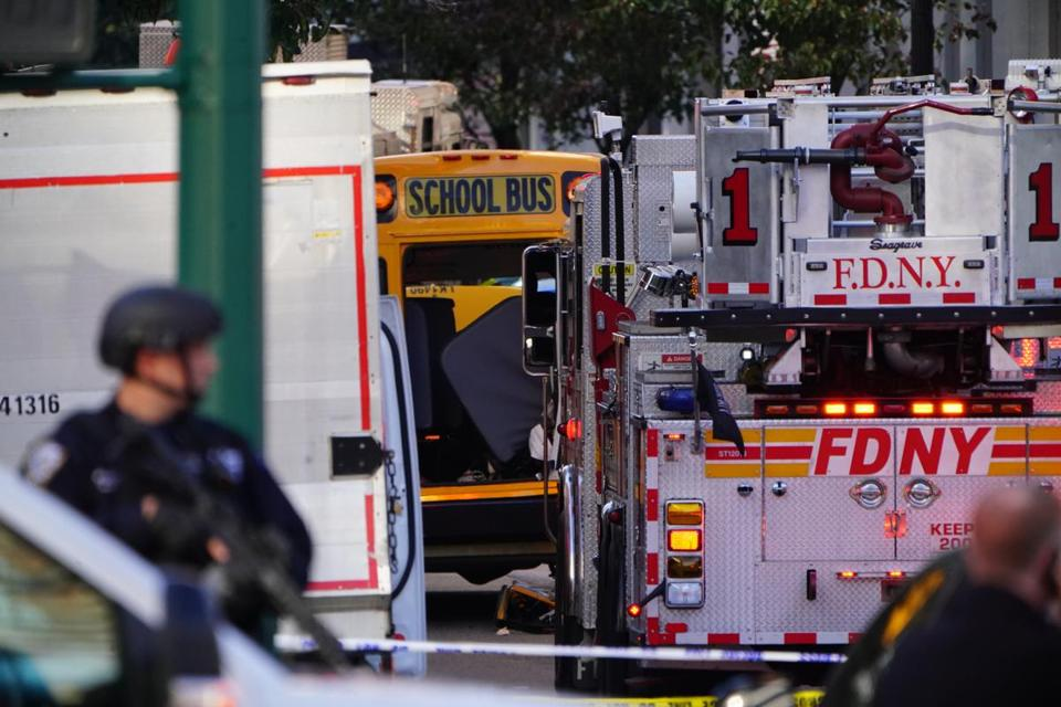 Emergency vehicles and a school bus were outside Stuyvesant High School in Manhattan.