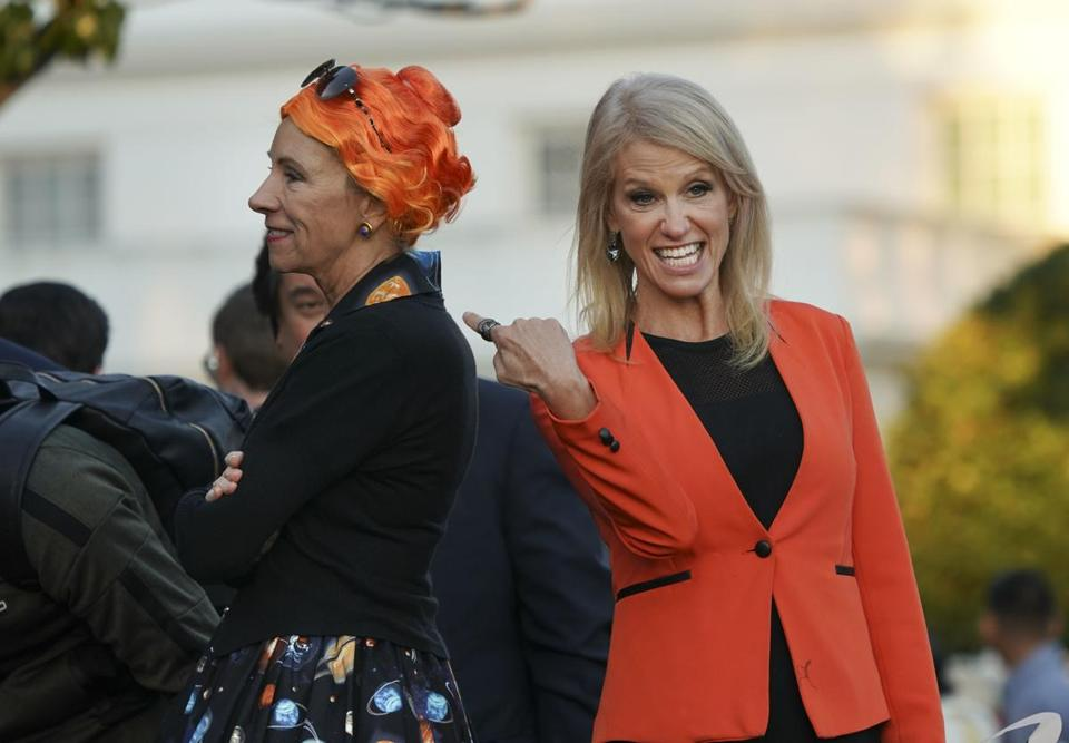 Kellyanne Conway (right) pointed at Education Secretary Betsy DeVos' costume during a Halloween event at the White House on Monday evening.