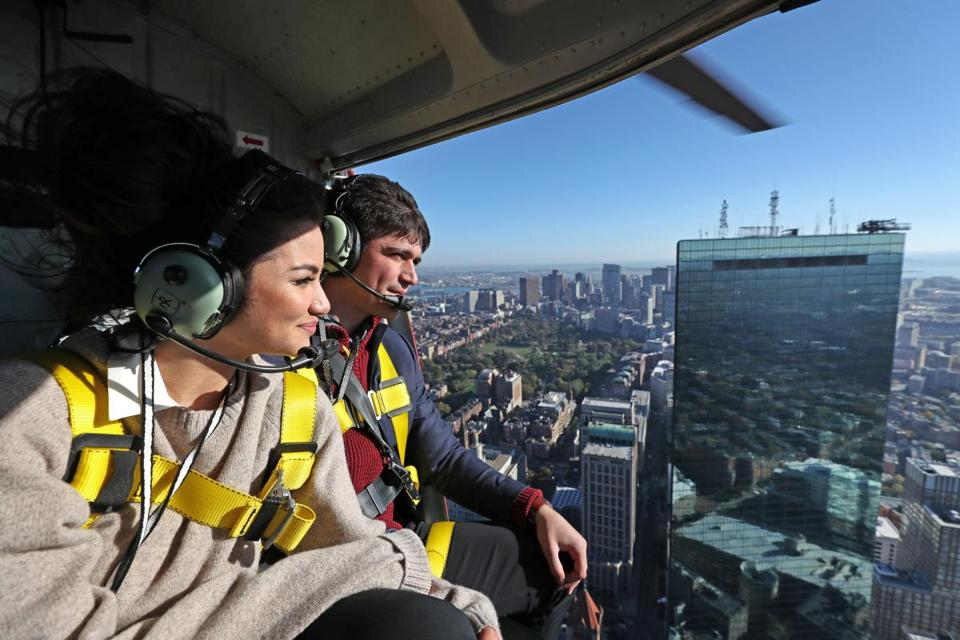 Caila Quinn and Nick Burrello on a Hover Boston flight over the city.