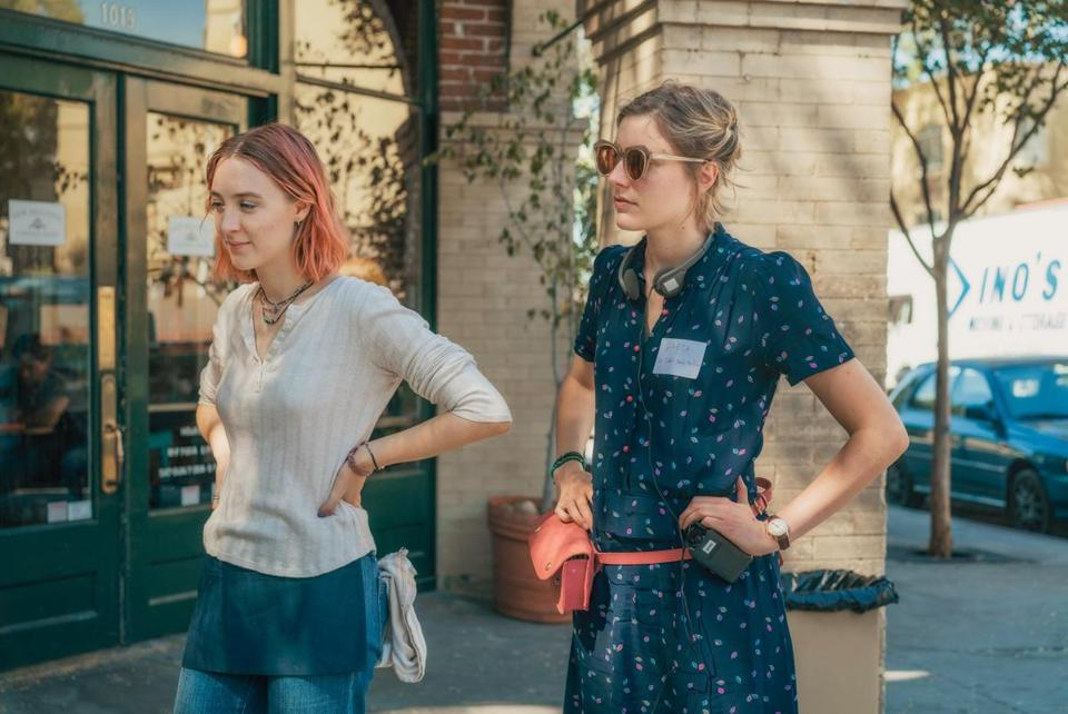 "Greta Gerwig (right) with star Saoirse Ronan on the set of ""Lady Bird."""