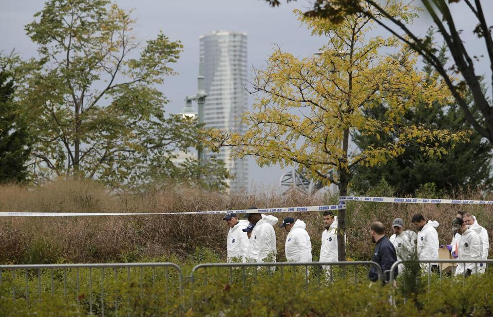 Crime scene investigators walked slowly down the west side bike path in lower Manhattan in Wednesday.