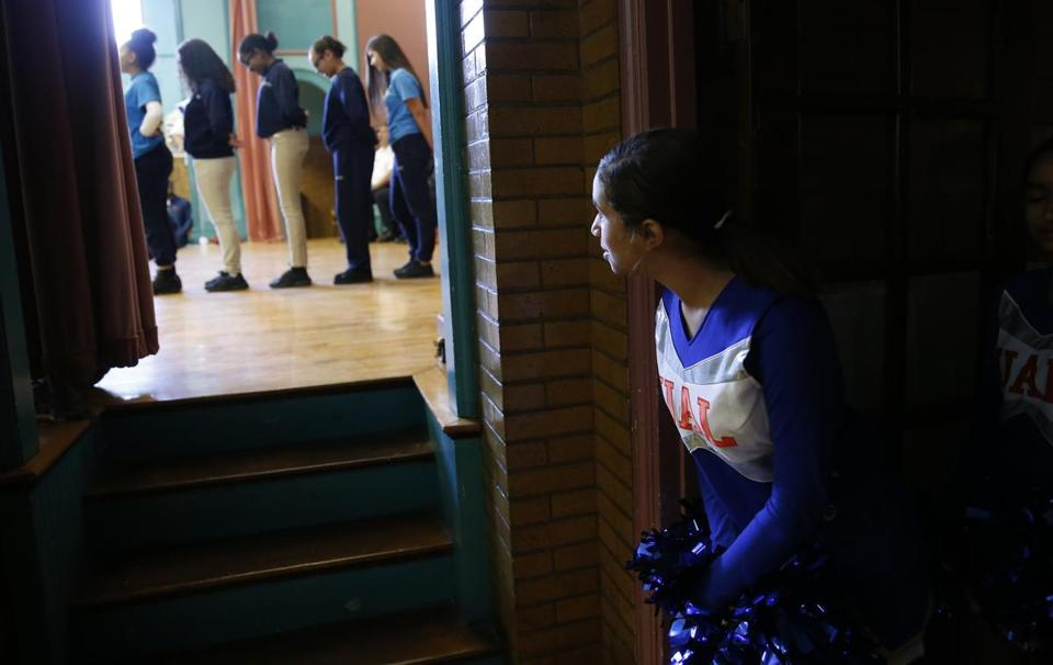 A cheerleader at Up Academy Leonard watched as the Step Team performed.