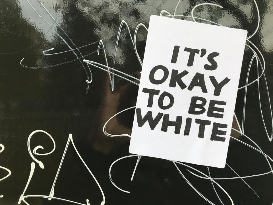 "One of the ""It's okay to be white"" stickers posted in Cambridge."