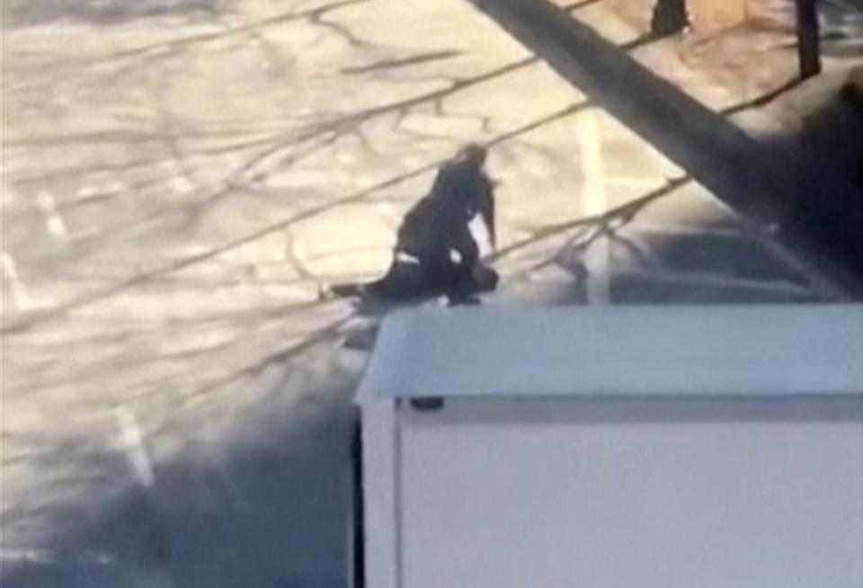 This image made from a video provided by Tawhid Kabir shows the suspect in a deadly attack being apprehended by police on Tuesday, Oct. 31, 2017, in New York. The man mowed down pedestrians and cyclists along a busy bike path near the World Trade Center memorial on Tuesday, before he was shot in the abdomen by police after jumping out of the truck, authorities said. (YouTube/Tawhid Kabir via AP)