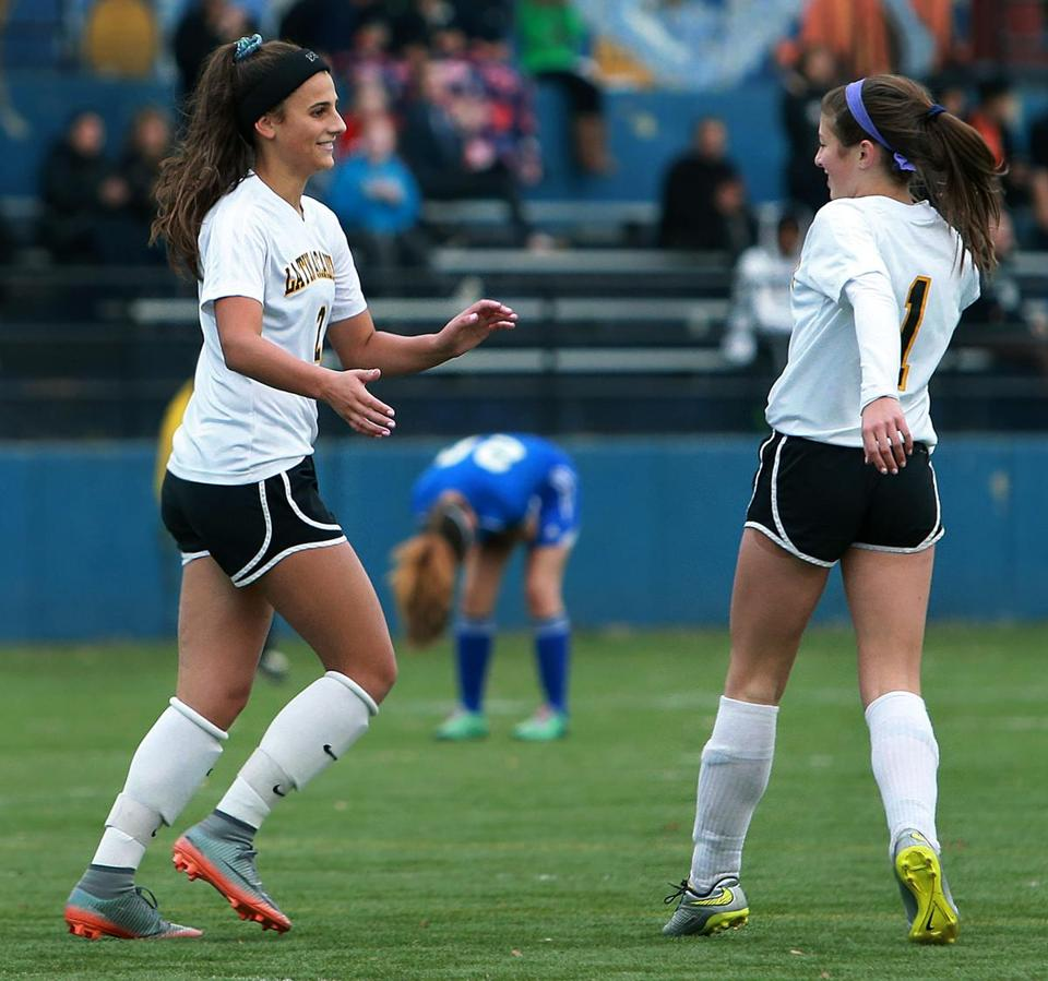 Boston, MA: 11-1-17: While an O'Bryant player reacts in the backround at center, Latin Academy's Elizabeth Frattaroli (left) celebrates her second half goal that put her team ahead 3-1 with teammate Anastasi Papajani (right). Latin Academy defeated O'Bryant 3-1 to win the girl's high school city soccer championship. (Jim Davis/Globe Staff)