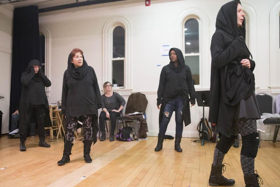 "Bryn Boice (seated) directs a rehearsal of ""Julius Caesar"" with (from left) actors Marya Lowry, Bobbie Steinbach, Jade Guerra, and Marianna Bassham."