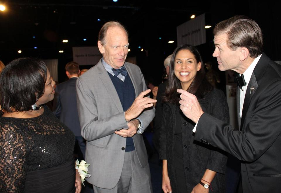 Livingston Taylor with Henrietta Oparah (left), Giselle Sterling, and New England Center and Home for Veterans CEO Andy McCawley (right).