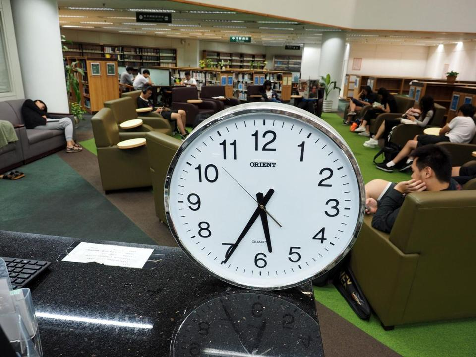 Mandatory Credit: Photo by DAVID CHANG/EPA-EFE/REX/Shutterstock (9159182d) A clock in a university library in Taipei, Taiwan, 19 October 2017. On 19 October, the United Evening News reported that some Taiwanese are urging the government to move the clock one hour further behind the GMT, so that Taiwan can leave China's time zone and show the world that Taiwan is not part of China. The proposal was made by one person on the parliament's website and nearly six thousand people have joined in the debate, with some backing the idea while others oppose it. Currently Taiwan obseves the Beijing Standard Time, which is eight hours behind GMT, while Japan and South Korea are nine hours behind the GMT. Opponents say that the suggestion to change time zone is politically-notivated and ridiculous. They warn that changing time zone will cause many problems, including disrupting international flights and affecting financing firms' operation. China sees Taiwan as its breakway province and has threatened to recover Taiwan by force if Taipei declares independence or indefinitely delays holding unification talks with the mainland. Pro-independence Taiwanese urge Taiwan to change time zone, Taipei City - 19 Oct 2017