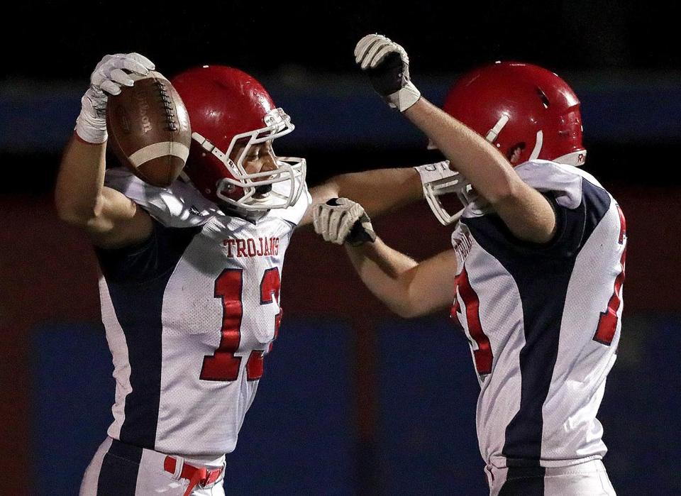 Natick, MA - 11/03/2017 - BW-R running back Devante Greaves, (13), at left celebrates his long run for a touchdown for a 21-7 lead late in the second quarter. Bridgewater-Raynham at Natick in a Division 2 South football semifinal. - (Barry Chin/Globe Staff), Section: Sports, Reporter: Brendan Hall, Topic: 04HS football, LOID: 8.3.4233587979.