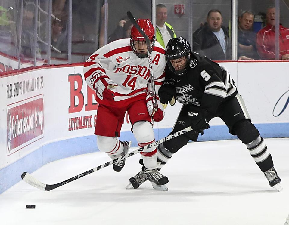 Boston Ma 11/03/17 Boston University Bobo Carpenter battles Providence College Tommy Davis for control of the puck during first period action at Agganis Arena. (Matthew J. Lee/Globe staff) topic reporter