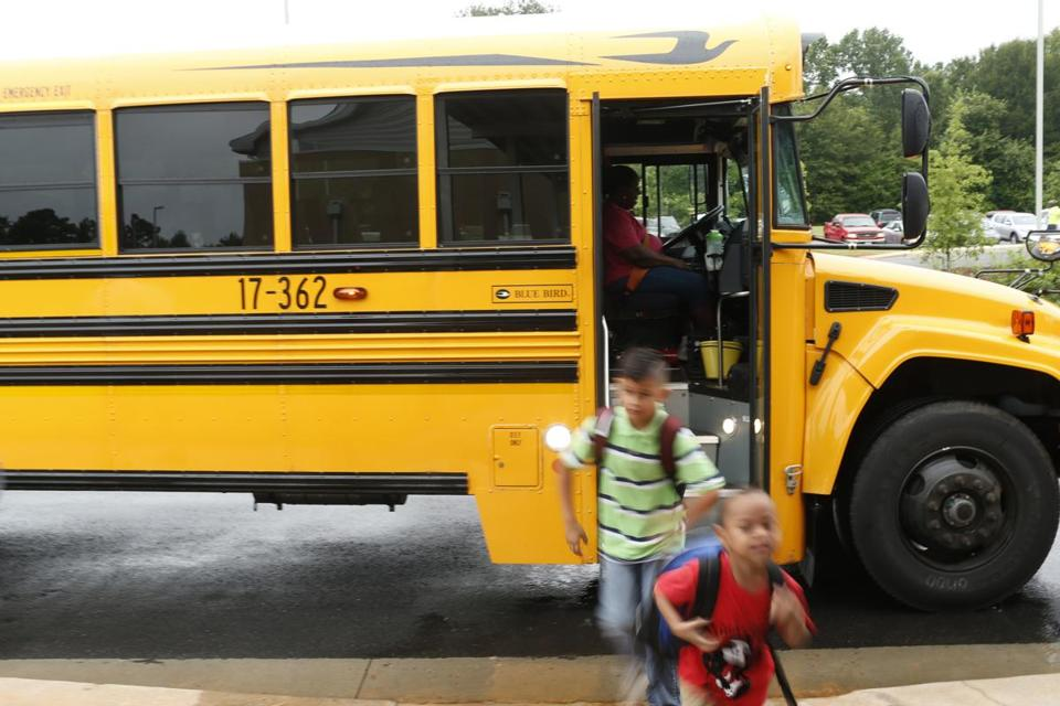 Students get off the bus at Barnett Shoals Elementary in Athens, Ga., on Wednesday, Aug. 9, 2017. (Joshua L. JonesAthens Banner-Herald via AP)