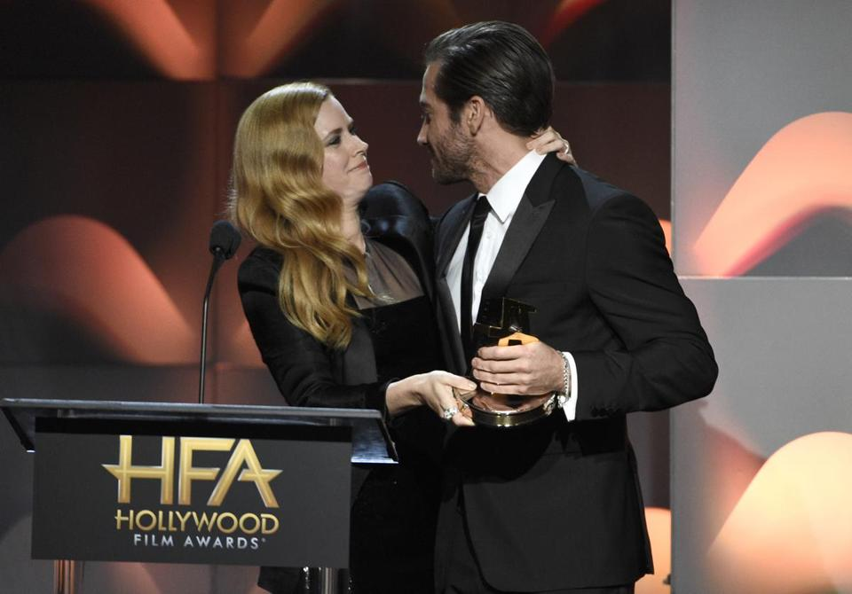 "Amy Adams presents Jake Gyllenhaal with the Hollywood actor award for ""Stronger"" at the Hollywood Film Awards at the Beverly Hilton hotel on Nov. 5."