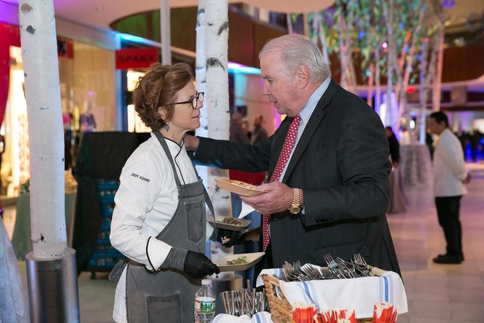 Joe O'Donnell talks with chef Jody Adams at the annual Joey Fund Film Premiere Sunday.