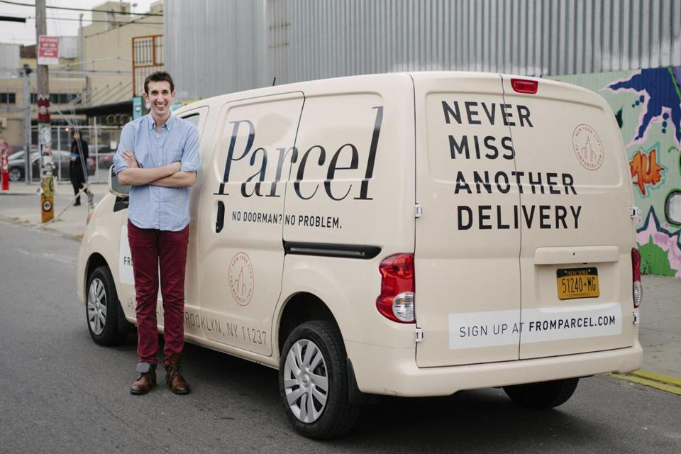 Jesse Kaplan, founder of Parcel Inc., posed with a cargo van from Parcel's fleet in 2014.