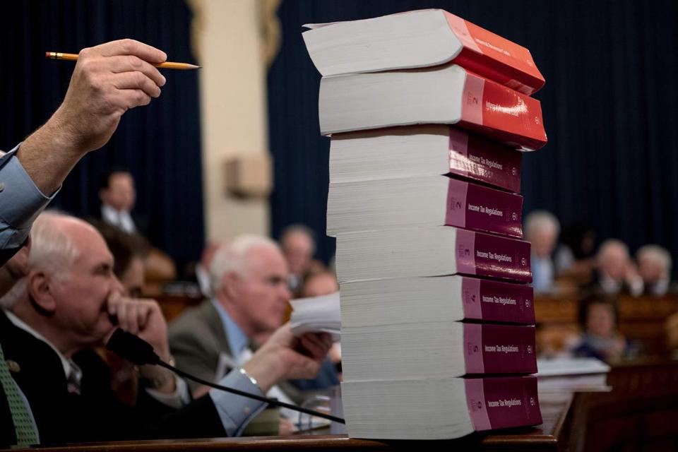 A copy of the proposed Tax Cuts and Jobs Act loomed on a table Monday during the House Ways and Means panel hearing.