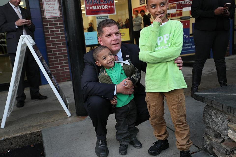Mayor Martin J. Walsh posed for photos with Kaiden Perez (left) and his brother Davian after receiving an endorsement from the Dominican American Coalition.