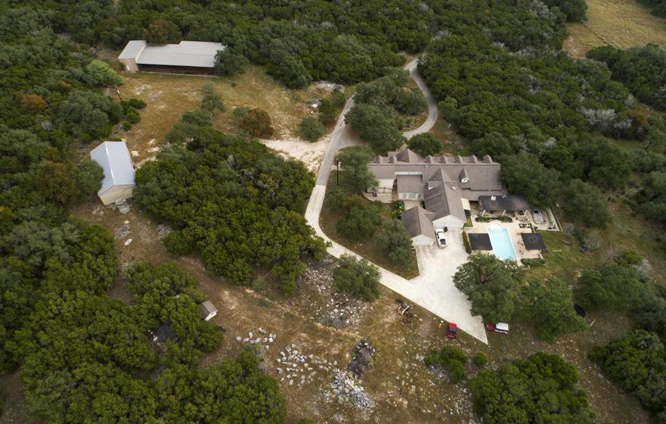 This shows the home of Devin Patrick Kelley in New Braunfels, Texas, on Monday, Nov. 6, 2017. Texas officials confirmed Kelley as the shooter who killed more than 20 people and wounded others at a church in Sutherland Spring, Texas, Sunday. (Jay Janner/Austin American-Statesman via AP)