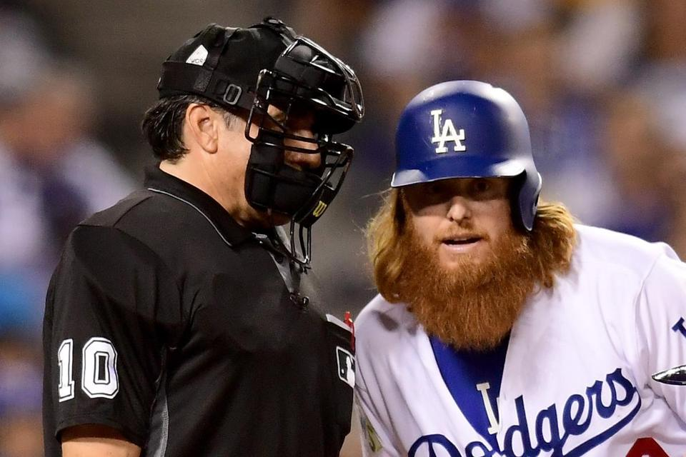 LOS ANGELES, CA - OCTOBER 24: Justin Turner #10 of the Los Angeles Dodgers talks with home plate umpire Phil Cuzzi #10 in game one of the 2017 World Series at Dodger Stadium on October 24, 2017 in Los Angeles, California. (Photo by Harry How/Getty Images)