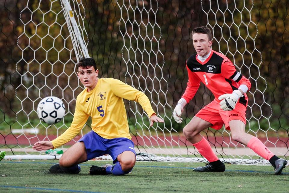 11/06/2017 SOMERVILLE, MA Boston Latin's Federico Rollo (cq) 5, helped goalie Jonathan Evans (cq) defend during a Division 1 Boy's soccer game between Somerville HS and Boston Latin at Dilboy Stadium in Somerville. (Aram Boghosian for The Boston Globe)