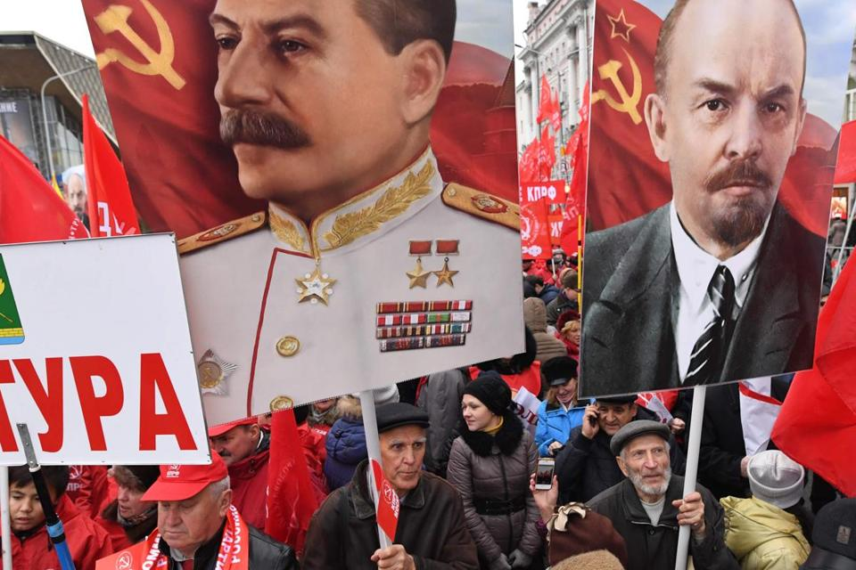 Russian supporters of communism holding posters depicting Soviet leaders Joseph Stalin and Vladimir Lenin celebrated the 100th anniversary of the 1917 Bolshevik Revolution in Moscow.