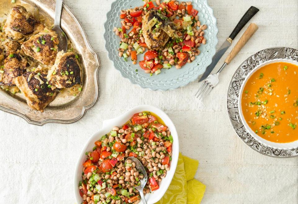 Chicken Yassa (left), Senegalese-style back-eyed pea salad (center), and West African-style peanut soup.