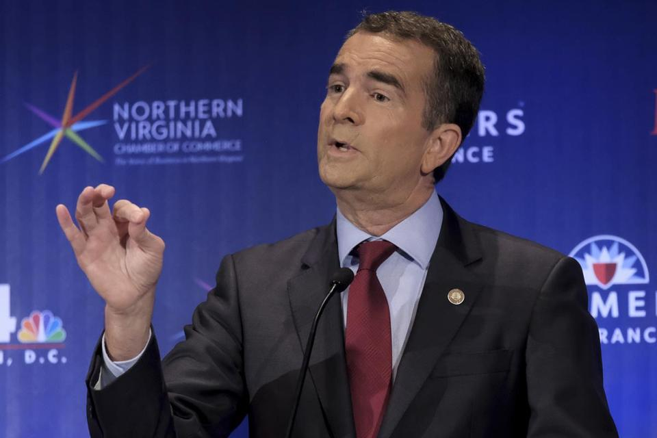 FILE - In this Sept. 19, 2017 file photo, Democrat, gubernatorial candidate Lt. Gov. Ralph Northam describes his view on confederate monuments in McLean, Va. Voters in Virginia and New Jersey are picking new governors in contests that could be an early referendum on President Donald Trump. The two gubernatorial elections on Tuesday, Nov. 7, pit two mild-mannered Democrats against two Republicans who have kept the president at arm's length. (Bonnie Jo Mount/The Washington Post via AP, Pool, File)