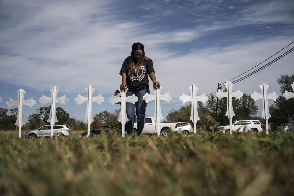Sheree Rumph prayed over crosses that were put up outside a gas station in Sutherland Springs, Tex., on Monday.