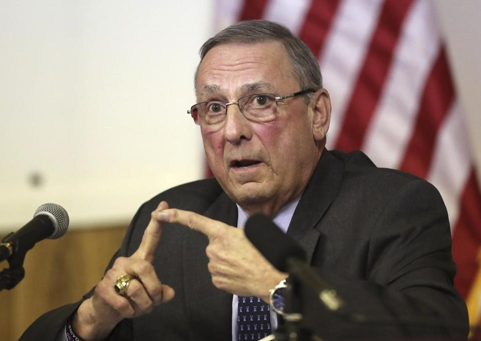 FILE-In this March 8, 2017 file photo, Maine Gov. Paul LePage speaks at a town hall meeting in Yarmouth, Maine. On Nov. 7, voters in Maine will decide whether to join 31 other states and expand Medicaid under former President Barack Obama's Affordable Care Act. LePage is steadfastly against against a referendum to expand Medicaid, which he calls big-government welfare. (AP Photo/Robert F. Bukaty, File)