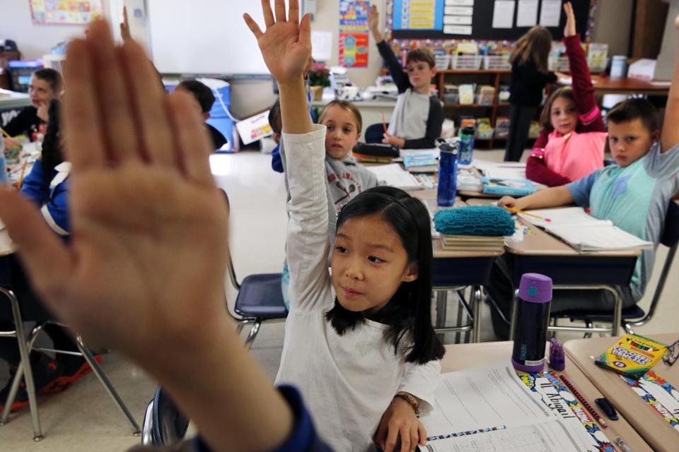Fourth-grader Abigail Nam, 10, raised her hand at Kittredge Elementary School in North Andover. The school's test numbers declined.