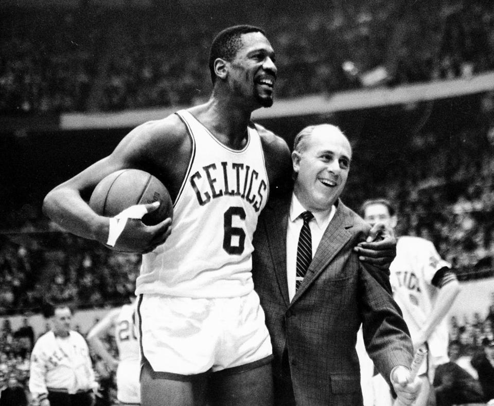 Legendary Boston Celtics center Bill Russell and coach Red Auerbach are forever linked in history.